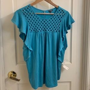 Cute flowy top. Light blue/turquoise in color. M